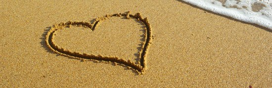 An image of a heart drawn in the sand
