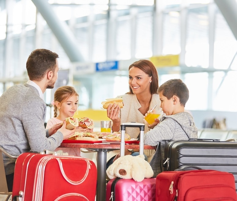 Family eating at airport