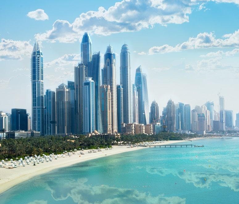 Dubai marina, beach and skyline in summer