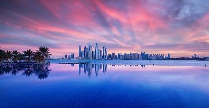 Dubai sunset with skyline reflection in water
