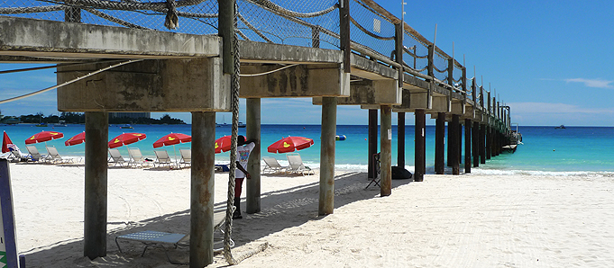 A wooden bridge on a beach in Barbados
