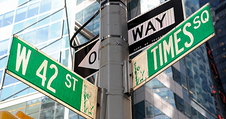 An image of New York street signs