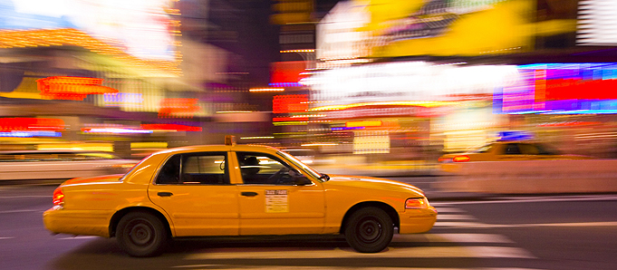 An image of a yellow New York taxi