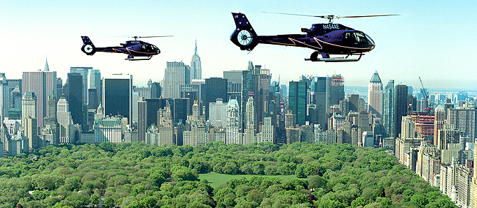 An image of helicopters above a New York skyline