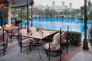Poolside dining at Dar Al Masyaf