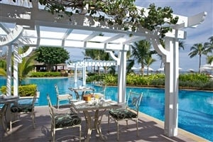 Poolside dining at Sugar Beach Resort and Spa