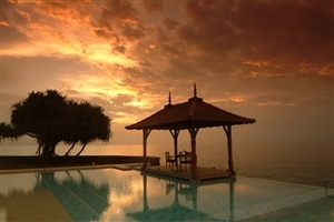 Infinity pool with sunset views